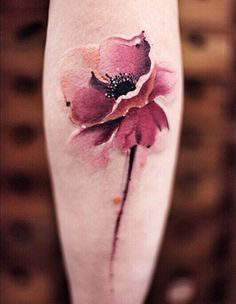 BELLY TATTOO-THIS WAS SKILLFULLY DONE. VERY ARTISTIC. Love how the artist captured the depth of the flower, while also smearing and softening the edges so it softly blends into the skin. Great skill. Love it.