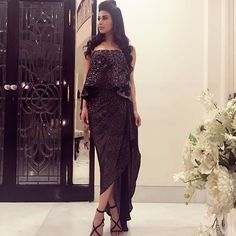 The thin strappy heels look super elegant and are a perfect fit for an evening cocktail. Mouni Roy has carried them off with a sexy off-shoulder dress, and she looks utterly gorgeous in the look. Mode Bollywood, Bollywood Fashion, Western Outfits, Indian Outfits, Lengha Dress, Lehenga, Mouni Roy Dresses, Stylish Dresses, Fashion Dresses