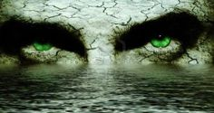 Faerie Inspirations Mysterious cracked face with intense green eyes Stock Photo