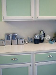 Ideas for painting your kitchen cabinets, plus tutorials (transforming dark wood panel, plastic laminate kitchen cabs, general paint cabinet tutorials).