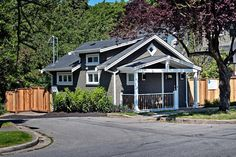 A laneway cottage with traditional appeal by Smallworks in Vancouver, B.C