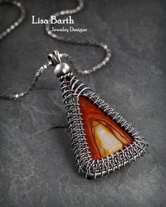 Classic woven bezel pendant.   If you'd like to learn how to do this, I wrote a book all about it.  http://www.amazon.com/Timeless-Wire-Weaving-Complete-Course/dp/1627000763/ref=sr_1_1?ie=UTF8&qid=1407288793&sr=8-1&keywords=timeless+wirework