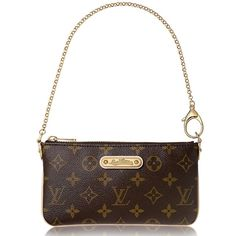 "Louis Vuitton Monogram Milla MM Pochette Pre❤️. This is an authentic LOUIS VUITTON Monogram Milla MM Pochette. The bag features vachetta cowhide leather trim on a top wrist chain with a detachable end that will attach to your Louis Vuitton handbag. Zipped closure. golden metallic Louis Vuitton signature plaque. Length: 8"", Height: 4"", Drop: 7"". Comes with dust bag. Item condition - Very Good. Louis Vuitton Bags Clutches & Wristlets"