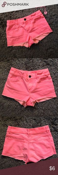 Divided by H&M hot pink shorts These super cute shorts are pretty stretchy! The dye adds a bit of variety in color as seen on the back pockets. Bottom is distressed for a really cute look! And the pockets are real!! These shorts are very small so please check the measurements before purchasing! Bundle for a great deal!! Measurements  Waist: 25 inches Rise: 8 inches Inseam: just over 1 inches Overall length: about 8 inches H&M Shorts