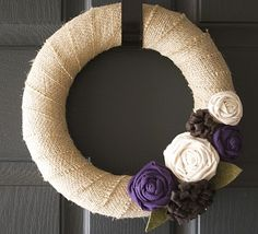 Burlap wreath with fabric flowers.