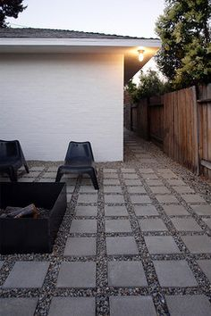 square pavers with gravel - could be a great solution for side yard/dog run.