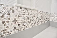 Lutherville-Timonium, MD: A lovely combination of textures: Mother of pearl honeycomb on a white herringbone background.  www.jpaulbuilders.com/?utm_content=buffer665e8&utm_medium=social&utm_source=pinterest.com&utm_campaign=buffer | #JPaulWally