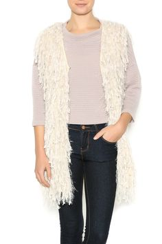 Knit vest with fuzzy tassels, mid thigh length and an open front. A great styling piece when you want to funk up your look.  Fuzzy Vest by AAKAA. Clothing - Jackets, Coats & Blazers - Vests Beverly Hills, Los Angeles, California
