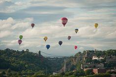 Bristol International Balloon Fiesta balloons fly over the Clifton Suspension Bridge Bristol Balloon Festival, Bristol Balloon Fiesta, Bristol Cars, City Of Bristol, Clifton Bridge, Bristol England, London Life, Hot Air Balloon, Wild West