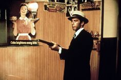 A deleted scene from The Godfather where Michael Corleone shoots his wife's killer. Courtesy of Everett Collection