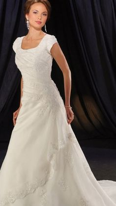 Bonny Bliss style 2901 - beautiful modest wedding dress with short sleeves and ruched bodice. Subtle beading with delicately edged layer on skirt adds delicate detail