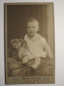 Vintage cabinet card of baby boy with bear