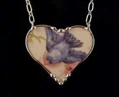 Antique bluebird china broken china jewelry heart pendant necklace made from a broken plate. $70.00, via Etsy.