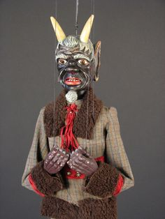 Antique devil marionette.