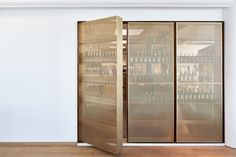 Door-like beverage storage designed by Retail Architects and Årstiderne Arkitekter. Photo by Mads Frederik.