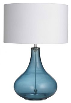 The simplicity of the Paloma Table Lamps with their blue glass bottle bases and fresh white shades provides a contemporary vibe be it city or coastal. Work with bleached or crisp white painted timber furniture for contrast and a sun drenched aesthetic. Timber Furniture, My Furniture, Furniture Online, Blue C, Blue And White, Timber Table, Blue Glass Bottles, Interiors Online, Homewares Online