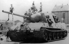 Jagdtiger - Germany, 1944  70 tons - 2,95 m tall, 10,5 m long.  The 12,8 cm anti-tank gun combined with a ridiculous 250mm of frontal armour resulted in an almost invincible vehicle in theory. Practically they mostly ended up isolated and flanked, or immobilised and abandoned due to the poor supply situation towards the end of the war. Based on Tiger II chassis.