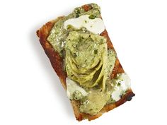 Artichoke-Pesto Bites : Mix 1/2 cup each ricotta, chopped artichoke hearts and pesto with 1/4 cup grated parmesan, and salt and pepper. Spread on focaccia and top with mozzarella. Bake 10 minutes at 375 degrees F.
