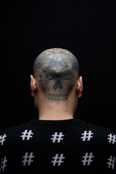 Tattoo artist 'Six' poses for a photo at the Tattooism tattoo studio in Seoul on December 14, 2014