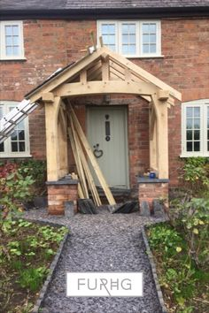 One of our oak porches being installed by a customer.