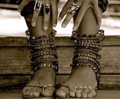 many ankle bracelets.