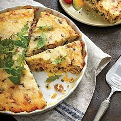 Sausage-and-Grits Quiche | Impress your brunch company with this clever, simple spin on a traditional quiche. | SouthernLiving.com