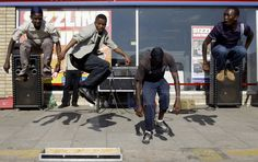 People dance in the street a day before the start of the Confederations Cup soccer tournament in Rustenburg, South Africa, Saturday, June 13, 2009. (AP Photo/Paul White)