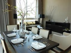 Silver Sophistication  An ideal place to incorporate silver is in the dining room and adjoining spaces. The trick is to use it sparingly as Ammie Kim has done here with silver flatware, oversized lamps and candlesticks.