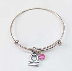 Happy birthday, October!!! Celebrate your own birthday or get the perfect gift for a loved one. Libra- Balance, Beauty, Truth Silver plated adjustable bangle with silver plated libra zodiac sign and swarovski october birthstone charms $22. Available @ http://shareindipity-com.myshopify.com/collections/zodiac-collection/products/silver-bangle-libra-with-october-birthstone #zodiac #libra #birthday #bangle #october #ootd #ootn #instafashion #photooftheday #silver