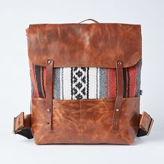 Handmade in Portland, OR, this backpack fits most laptops and books, you can sling it over your Handmade with Mexican patterned blanket and black canvas in the back. Back shoulder straps are reinforced with cotton webbing on the back.