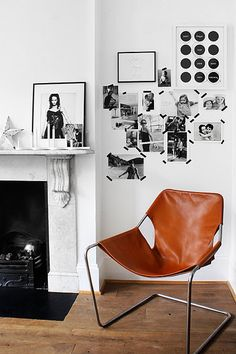 washi tape w/ b&w photos, white walls, leather sling chair, marble fireplace, #livingroom