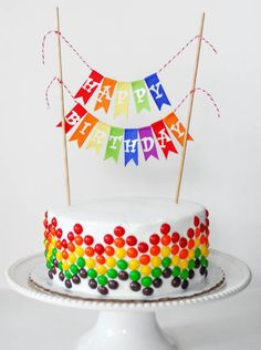 This looks fun, could also be done easily in icing. Good for a chocolate cake at a rainbow themed party.