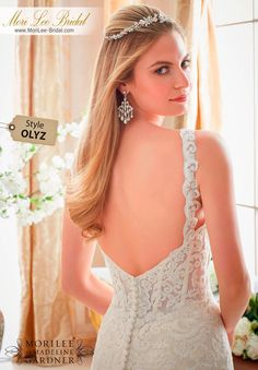 Dress Style OLYZ  EMBROIDERED LACE APPLIQUES ON TULLE WITH WIDE SCALLOPED HEMLINE  Available in Three Lengths: 55 , 58 , 61 . Colors Available: White, Ivory, Ivory/Light Gold