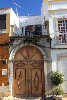 A doorway in Sao Bras de Alportel, Portugal  Photograph by Judith Morris