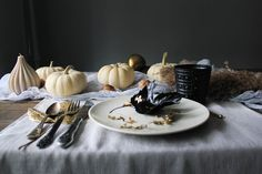 Autumn decor with white pumpkins, candles, gold and black