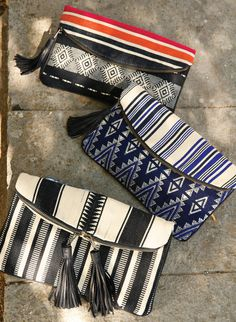 Handwoven in Guatemala, the foldover clutch bags showcase Mayan geometrics, made modern with leather tasseled zip tops and full lining. Proceeds benefit Guatemalan women artisans.
