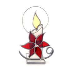 Decorate your home for the holidays with this Christmas candle and poinsettia tea light holder! Featuring a glass Christmas candle in your choice