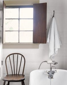 I know about a gazillion home owners who wouldn't have the guts to leave this palette alone.  How easy it would be to add your favorite tint?  But it would be a crime!    I'm in love with the window, the shutters, the chair, the hook, the white wood paneling.  Perfection.    Don't change a thing!