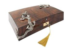 Part of the allure of smoking cigars comes from the luxurious accessories. Lotus Arts de Vivre's Pommele wood cigar humidor is adorned with two sterling silver dragons, storing up to 100 cigars in high style.