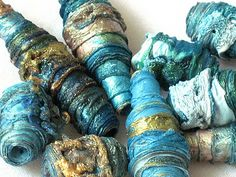 beads by Carolyn Saxby~~I am a textile artist living in St. Ives, Cornwall. I love to work in mixed media with paint and stitch. I love to manipulate fabrics and plastics with heat to alter their appearance and create interesting textures. I use these pieces along with found objects from the beach and nature (shells, sea glass, pottery pieces, seaweed, feathers, leaves, seed heads and pressed flowers) which I mix with vintage photos and fabrics to create one of a kind pieces of textile art