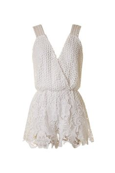 Lovely in white lace, this spring romper is so ultra femme!  Pair with sandals or a block heel to dress up. -Lined -80% Polyester -20% Spandex