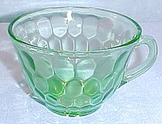 Hex Optic, or Honeycomb, green depression glass cup. made by Jeannette Glass from 1928-1932.