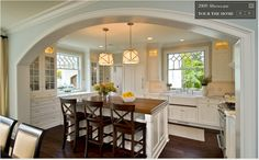pretty, love the built-ins and the arch way
