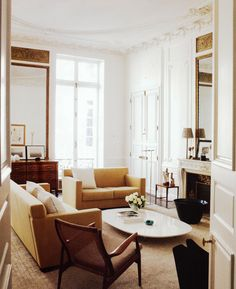 love the modern furniture juxtaposed to the elaborate moldings