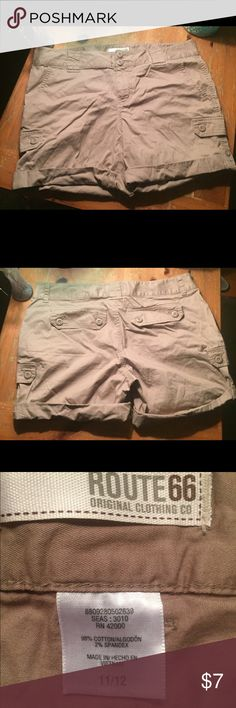 Lightweight khaki shorts Cute lightweight khaki shorts with folded up legs that have buttons to secure brand new without tags, bought the wrong size. Route 66 Shorts Cargos