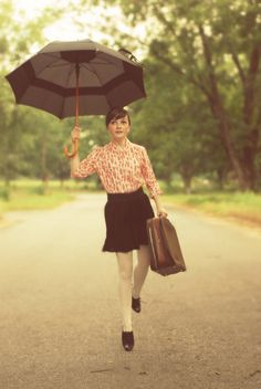 A young modern version of Mary Poppins? Like the little black skirt - very cute.