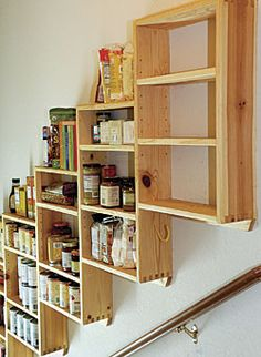 Pantry shelves over the basement garage stairs