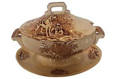 French brown transfer ware sauceboat with lid decorated with hunting dogs.  Made by Veneur, Longchamp. 9.5″ L x 6.5″ W x 7″ H