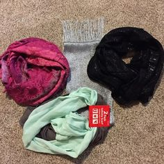 Scarves Five scarves!!!  One infinity black with sparkles.  One infinity pinks and purple.  Two pack infinity in green and brown.  One not infinity in silver.  All new never worn. Accessories Scarves & Wraps