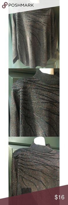 ✨ 80s Vintage Sparkly Unique Oversized Sweater - One of a kind sparkly sweater perfect for the holidays! - Pictures do not do this sweater justice, black sweater and the sparkles throughout are gorgeous - blue, pink, white, gold - On the right side there is a black design that goes across the sweater like vines  - Slight turtle neck, comes up high  - Has shoulder pads, can easily be removed  - Material: 74% acrylic, 17% polyester, 9% metallic  - Brand: Vintage  - Size: tag says 22/24 but…